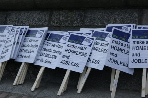 An image of placards with messages protesting against Family Mosaic redundancies.
