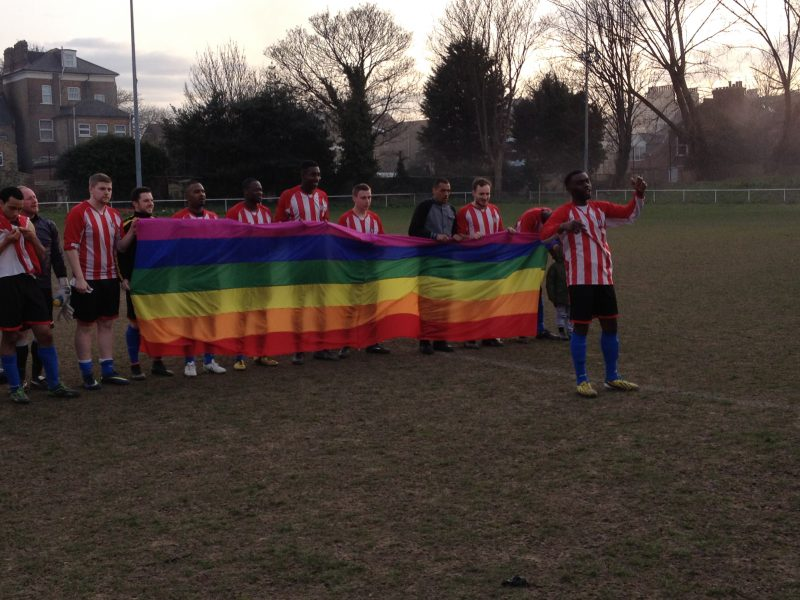 An image of Clapton's players celebrating their win with a LGBT flag.