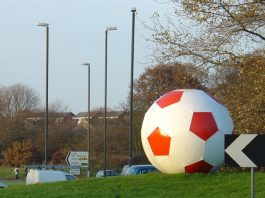 The A23 roundabout next to the stadium featuring a giant football.