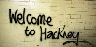 An image of 'Welcome to Hackney' street art.
