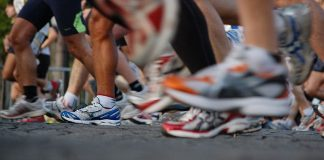 An image of running shoes in a marathon.