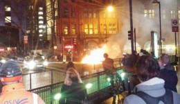 Pedestrians at Old Street watch the burning card Image: @adammarkjones
