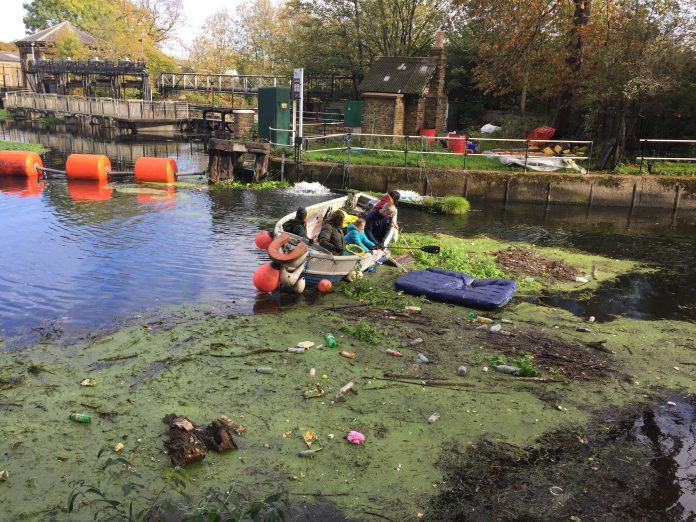 Members of Plastic Free Hackney cleaning up the River Lea